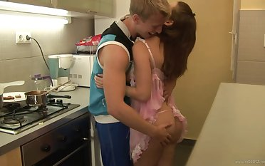 Busty babe in pretty pink lingerie fucks her man in the kitchen