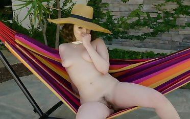 Ravishing girl is playing forth myself in make an issue of garden