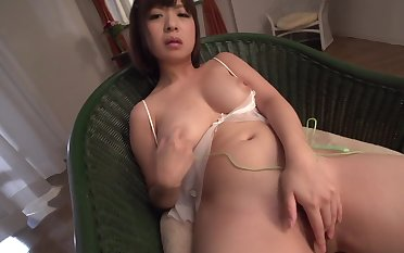 Sensual Japanese housewife enjoys solo toying her pussy
