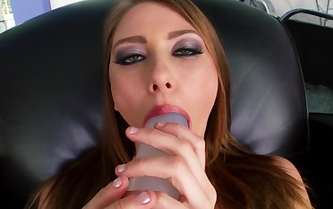 A shady licks a dildo coupled with she also uses a large vibrator