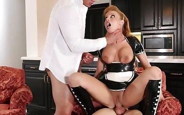 Gorgeous redhead maid is polishing two big peckers