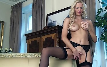 A blonde with stockings essentially is alone essentially the seat, massaging himself
