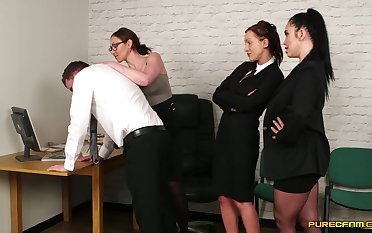Clothed office females share the boss's dick in potty manners