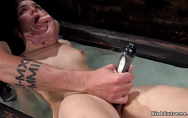 Babe in cage gets water bondage