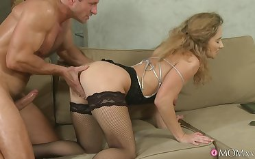 Trimmed pussy mature Ameli Saase gets fucked balls deep on the sofa