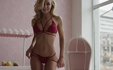 Young blonde teases with her tanned tits
