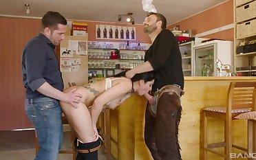 Horny brunette enjoys two big dicks in her tiny holes
