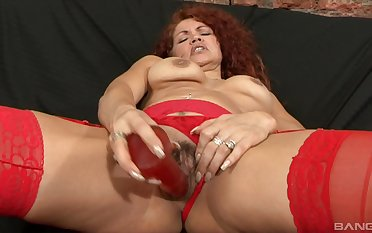 Mature redhead thither stockings gets a huge cumshot from a dismal dude