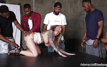 Inked whore Destiny RX gets her face saturated with cum in a gangbang