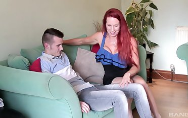 Mature redhead bombshell Julie Faye rides a younger dude to stockings
