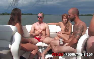 Slutty Canadian chick Kendra Sallow takes part in crazy yacht orgy with strapons