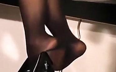 Gorgeous petite secretary influential in black pantyhose
