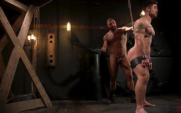 Muscular joyful males in rough scenes of male fetish