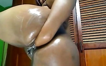Latina fists her BBW ass on cam