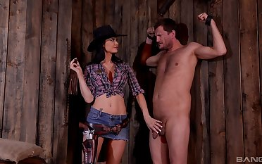 BDSM charm beau Jasmine Jae dressed as a cowboy humiliates the brush slave